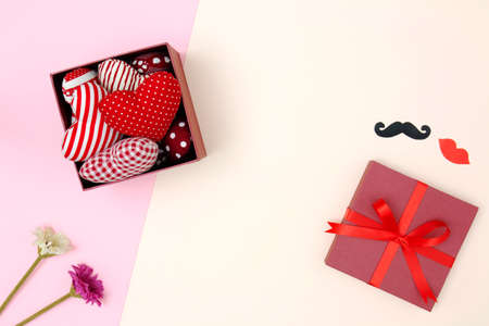 Flat lay of red pillows heart in gift box with copy space. Love and Valentines day concept. Minimal style.