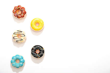 Set of colorful donuts isolated on white background. Stock Photo
