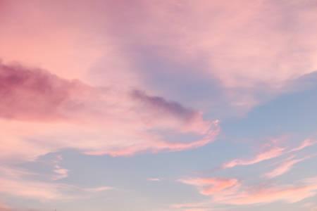 Pink cloud on blue sky. Soft pastel filter.