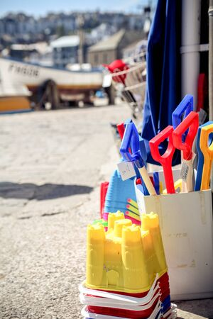 Buckets and spades for sale at the seaside