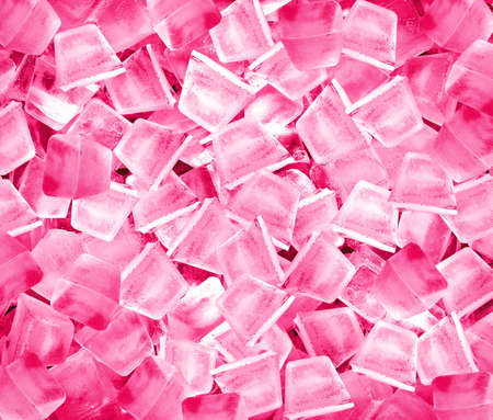 background with ice cubes in pink  light.