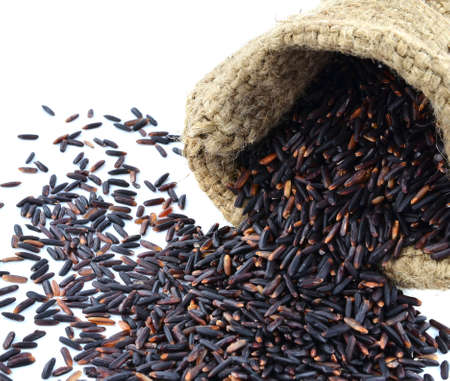 Black rice on a white background photo