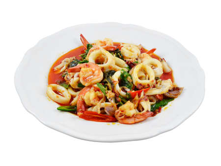 Thailand food, shrimp and squid stir-fried peppers and basil  photo