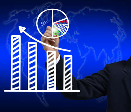 businessman hand drawing a graph. photo