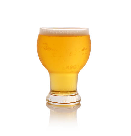 Glass of fresh beer with cap of foam isolated on white background photo