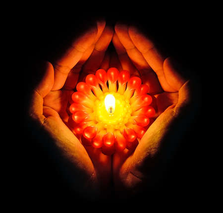 Candle in the hands photo