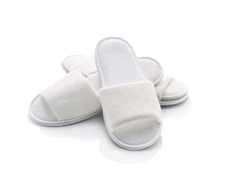 White casual home slippers on white background