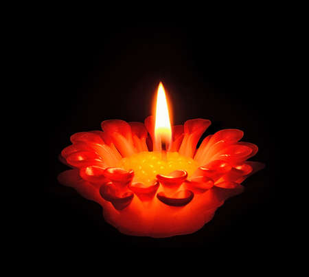 Burning candle in flower pattern photo