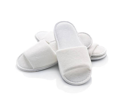 White casual home slippers on white background photo