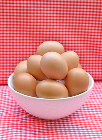 eggs in the bowl on  red background. Stock Photo