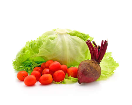 Tomato, lettuce and beetroot on white  photo