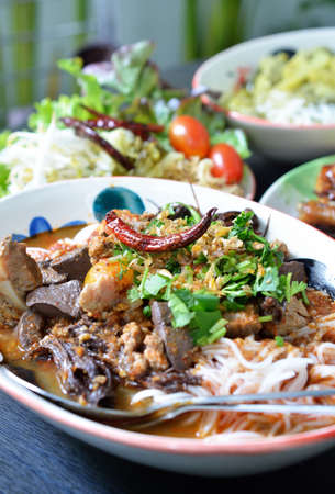 Thai rice noodles with spicy pork sauce photo