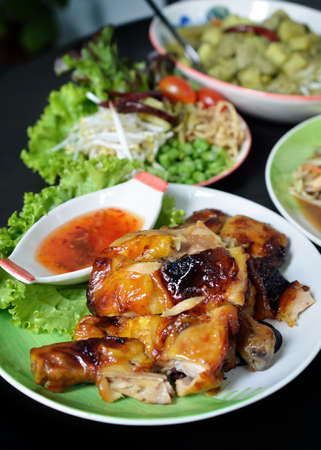 Grilled chicken with vegetables on the background. photo