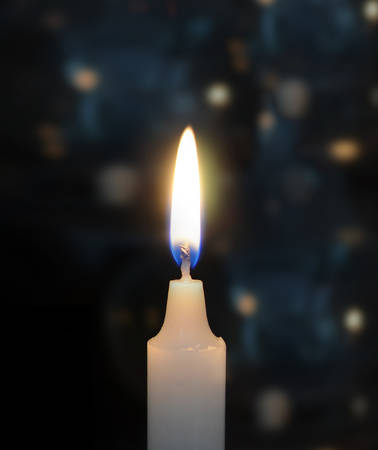 black and blue: Burning candles on black blue
