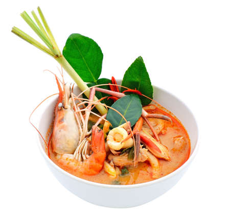 Tom Yum Goong or spicy tom yum soup with shrimp. Thai popular food menu, contained in bowl. photo