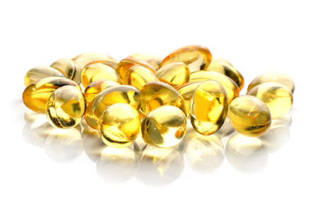 Fish oil pill on white background photo