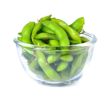 Edamame soy beans shelled in glass bowl photo