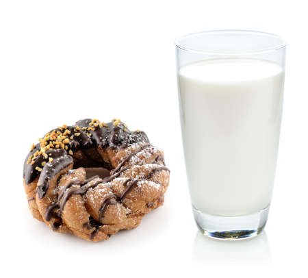 glass of milk and donut  isolated on white background photo