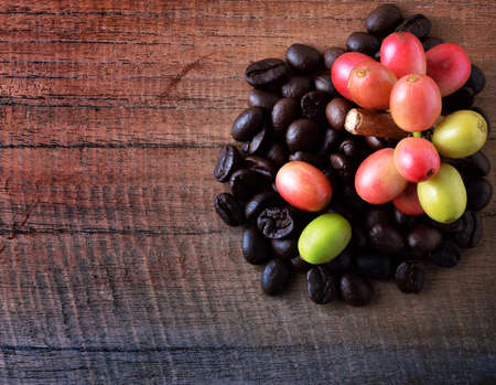 coffeetree: Coffee beans on wood background Stock Photo