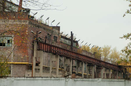 abandoned factory, view from behind the fence.