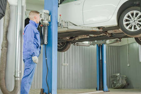 The car is lifted on the lift for diagnosis. Stock fotó