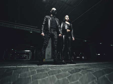 Masked man standing with a woman