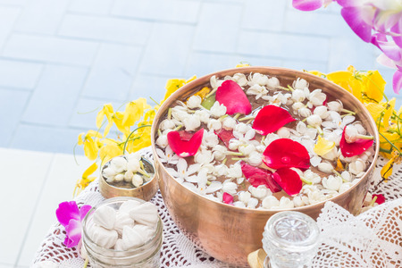 asian bowl: Water in bowl mixed with perfume and flowers, Songkran festival in Thailand.