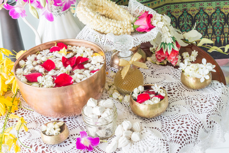 traditional wellness: Water in bowl mixed with perfume and flowers, Songkran festival in Thailand.