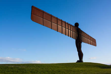 to the north: Angel of the North on the grass