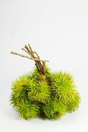 backgruond: Fresh green rambutan on white backgruond