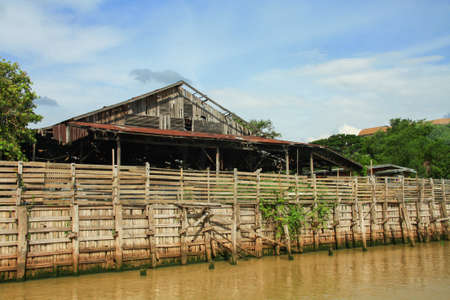 weatherworn: Old wooden wall protect water tidal
