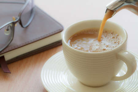 refills: Pouring coffee in to cup on the morning