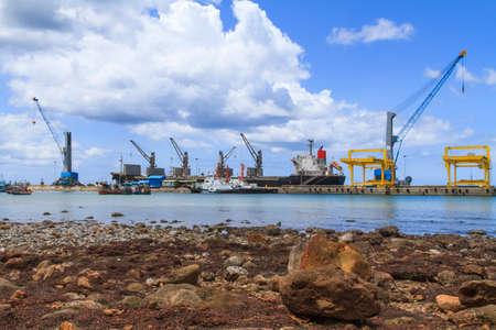Ship yard with heavy crane at rock beach photo
