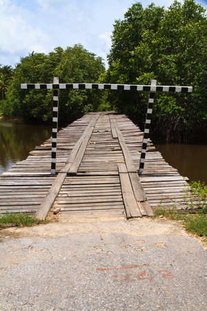 deteriorated: Deteriorated wooden bridge