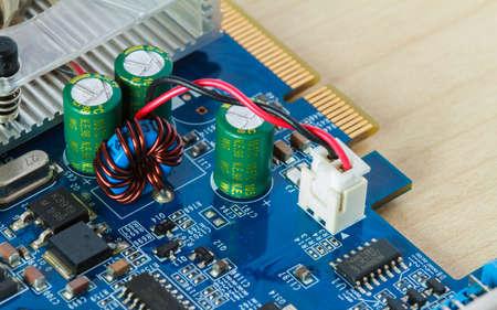electronic background: Electronic circuits on wood background