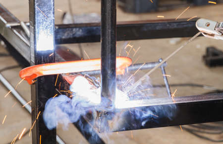 fabrication: Shield metal arc welding welding and C-clamp in fabrication work shop.