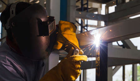 skilled labour: Welders were welding steel structural by shield arc welding. Stock Photo