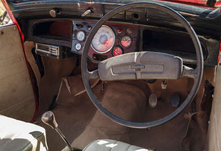 gearstick: Cockpit interior detail of an old car.