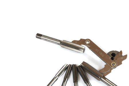 tapper: Mechanical hand tool set of screw tap and die cutting isolate on white background.