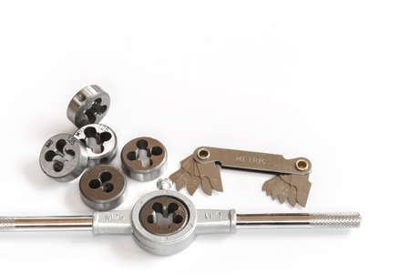 bolts and nuts: Professional mechanical hand tool set . Tap and die nuts for metal processing.