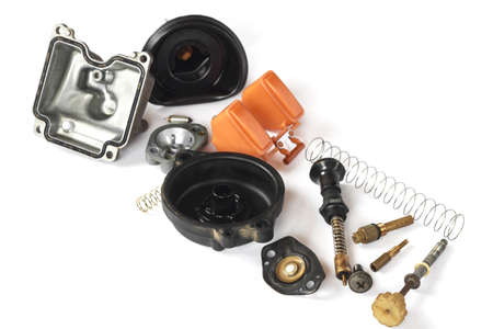 disassembly: Old carburetor of motorcycle part disassembly isolate on white background. Stock Photo