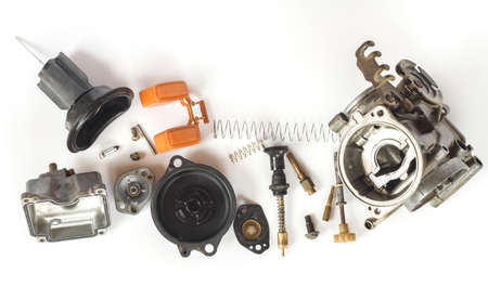 carburettor: Old carburetor of motorcycle part disassembly isolate on white background. Stock Photo