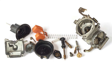 carburetor: Old carburetor of motorcycle part disassembly isolate on white background. Stock Photo