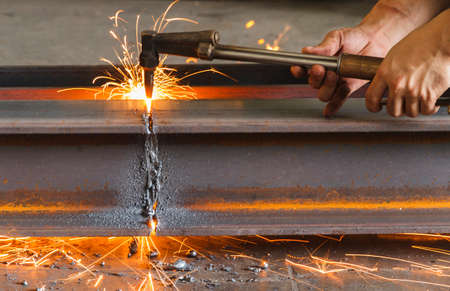 cutter: Metal cutter, steel cutting with acetylene torch, industrial worker on manufacturing area.