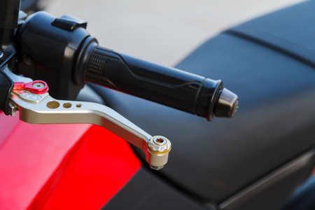 Close up of racing motorcycle handlebar and clutch lever.