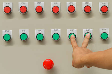 Forefinger and middle finger touch on green start buttons.