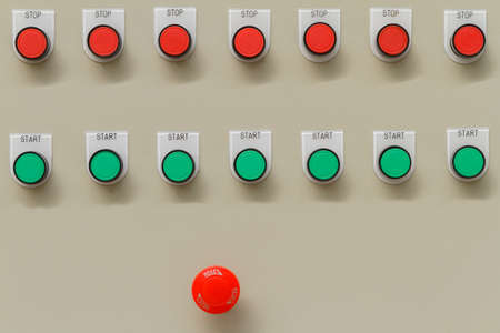 Red emergency and stop switch with green start buttons. Stock Photo
