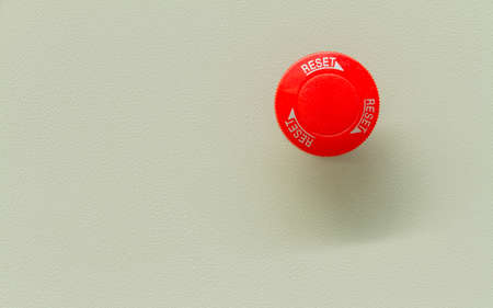 Red emergency stop and reset button.