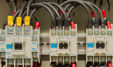 Close-up electrical wiring with fuses and contactor.