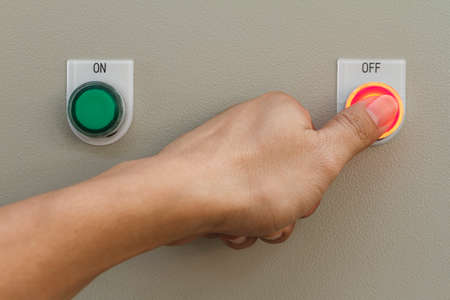 Thumb touch on red off switch button.